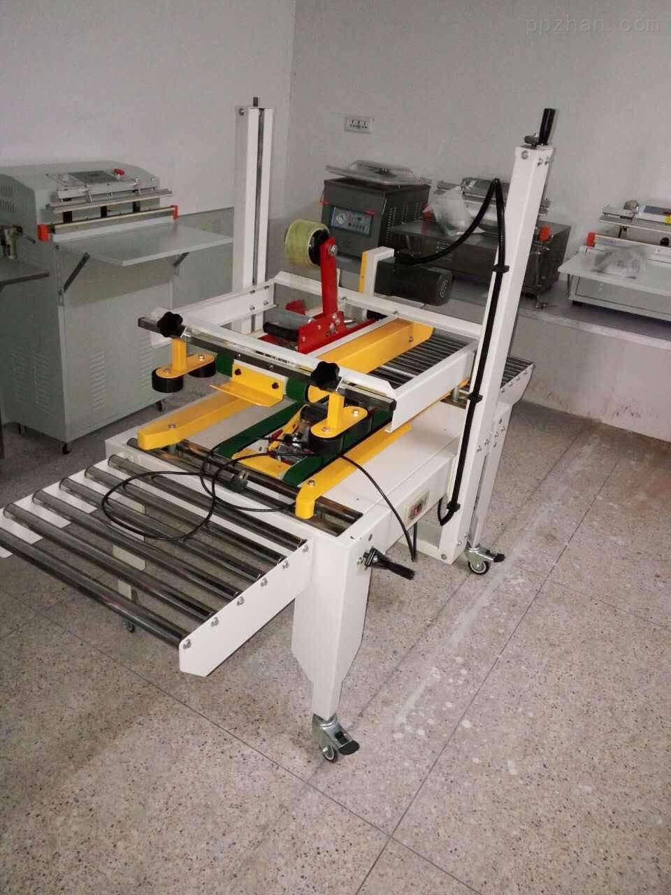 工字型纸箱全自动封箱机--鑫儒奕驱动型